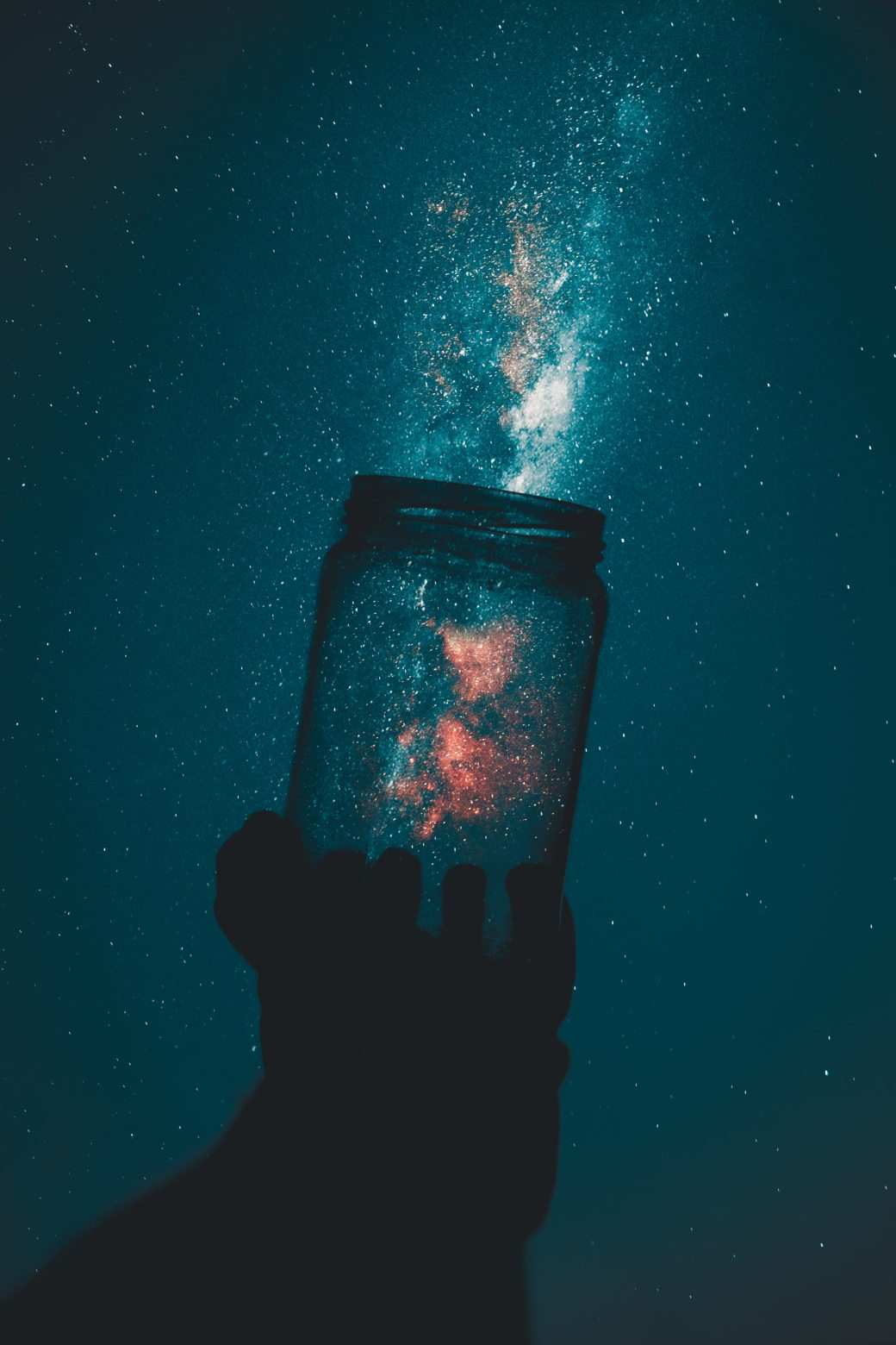 silhouette-of-person-holding-glass-mason-jar-1274260